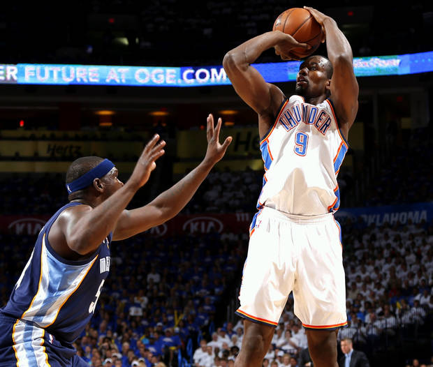 Oklahoma City's Serge Ibaka shoots the ball over Memphis' Zach Randolph during Game 2 in the second round of the NBA playoffs between the Oklahoma City Thunder and the Memphis Grizzlies at Chesapeake Energy Arena In Oklahoma City, Tuesday, May 7, 2013. Photo by Bryan Terry, The Oklahoman