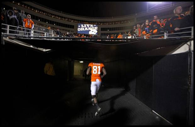 Oklahoma State's Justin Blackmon walks off the field after the Cowboys 47-41 loss to Oklahoma during the Bedlam college football game between the University of Oklahoma Sooners (OU) and the Oklahoma State University Cowboys (OSU) at Boone Pickens Stadium in Stillwater, Okla., Saturday, Nov. 27, 2010. Photo by Chris Landsberger, The Oklahoman