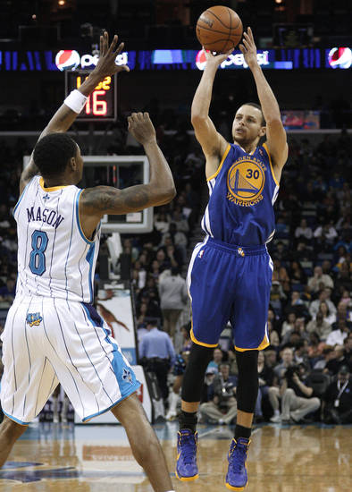 Golden State Warriors guard Stephen Curry (30) shoots over New Orleans Hornets guard Roger Mason Jr. (8) during the first half of an NBA basketball game in New Orleans, Saturday, Jan. 19, 2013. The Warriors won 116-112. (AP Photo/Jonathan Bachman)