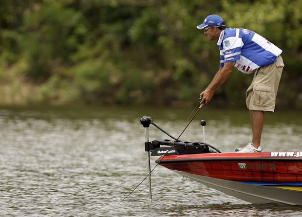 Marty Robinson fishes during the final day of the Bassmaster Elite Series Sooner Run on Grand Lake O' the Cherokees in Grove, Okla., Friday, June 24, 2007. By Matt Strasen, The Oklahoman