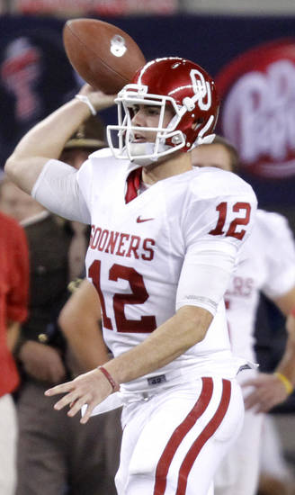 Oklahoma's Landry Jones throws the ball during the Big 12 football championship game between the University of Oklahoma Sooners (OU) and the University of Nebraska Cornhuskers (NU) at Cowboys Stadium on Saturday, Dec. 4, 2010, in Arlington, Texas.  Photo by Chris Landsberger, The Oklahoman