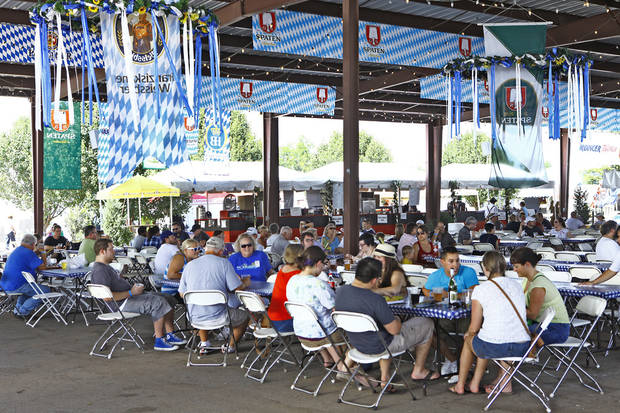 People enjoy food and beverages under a pavilion during Oktoberfest in the Park in Choctaw on Monday, September 3, 2012. Photo By David McDaniel/The Oklahoman