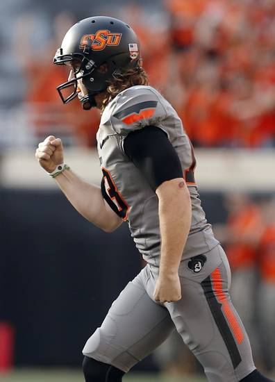 Oklahoma State&#039;s Quinn Sharp (13) celebrates a fumble recovery on a kickoff in the second quarter during a college football game between Oklahoma State University (OSU) and the West Virginia University at Boone Pickens Stadium in Stillwater, Okla., Saturday, Nov. 10, 2012. OSU won 55-34. Photo by Sarah Phipps, The Oklahoman