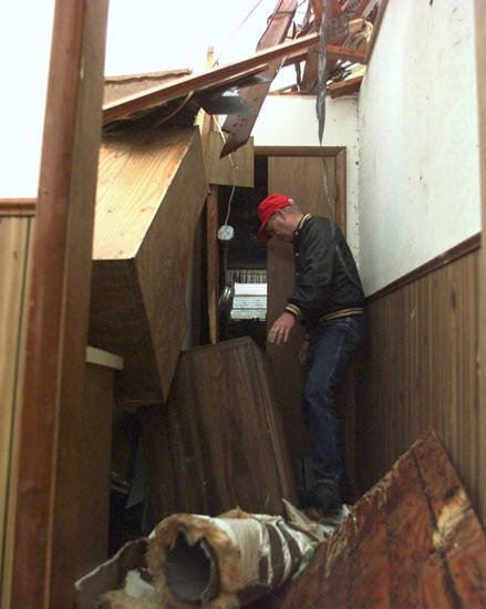 MAY 3, 1999 TORNADO: Tornado victims: Tornado damage. Sammy Duncan inspects his house.