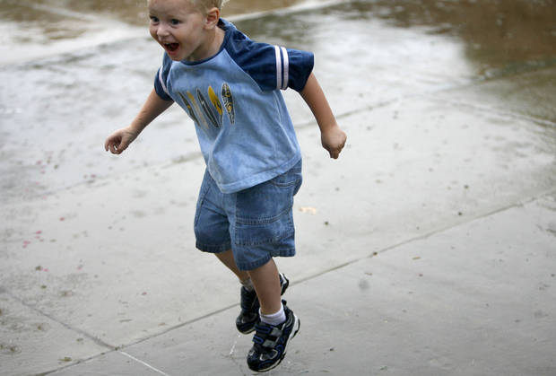 Xander Wilson, 3, jumps in puddles at the LibertyFest's ParkFest at the University of Central Oklahoma, Sunday, July 4, 2010, in Edmond, Okla. Photo by Sarah Phipps, The Oklahoman