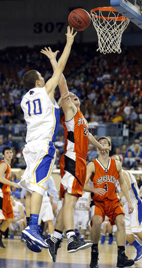 Glencoe's Jake Corbin shoots over during the Class A boys semifinal game of the state high school basketball tournament between Glencoe and Sterling at the State Fair Arena., Friday, March 1, 2013. Photo by Sarah Phipps, The Oklahoman