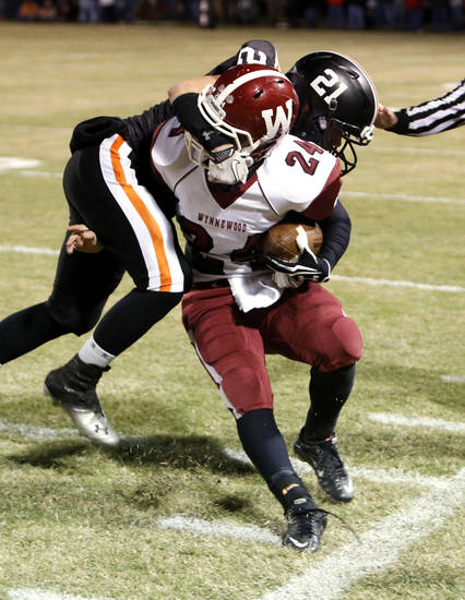 Wayne's Charlie Garnder (21) is called for a facemask penalty as he stops Wynnewood's T. J. Ellis (24) in high school Football on Friday, Oct. 26, 2012 in Wayne, Okla.  Photo by Steve Sisney, The Oklahoman
