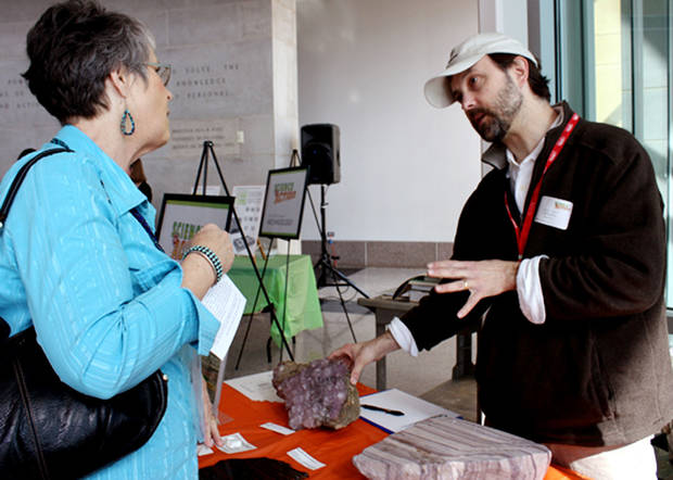 Lavada Crawford shows geologist Rick Lupia a geode she has found. Scientists were on hand Sunday at the Sam Noble Oklahoma Museum of Natural History in Norman to help people identify found natural history objects. PHOTO BY LYNETTE LOBBAN, FOR THE OKLAHOMAN <strong>Lynette Lobban</strong>