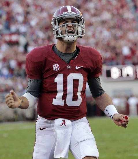 Alabama quarterback AJ McCarron (10) reacts after an Alabama score during the first half of an NCAA college football game against Texas A&M at Bryant-Denny Stadium in Tuscaloosa, Ala., Saturday, Nov. 10, 2012. (AP Photo/Dave Martin)
