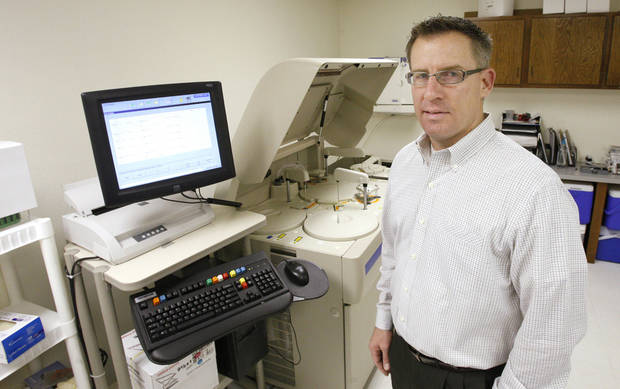 Jim Tedrow, president of Compliance Resource Group, stands in his lab where technicians screen some 375 urine samples a day for drugs and alcohol. Photo by Paul B. Southerland <strong>PAUL B. SOUTHERLAND</strong>