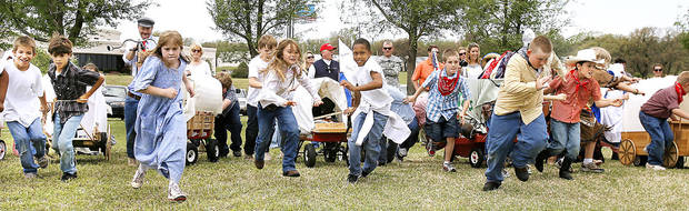 Edmond's Chisholm Elementary School third-graders participate in a land run reenactment. PHOTOS BY PAUL B. SOUTHERLAND, THE OKLAHOMAN