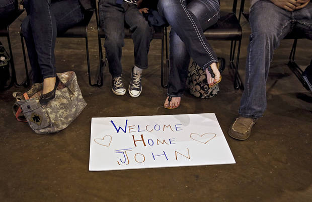 Family and friends gather to welcome home troops during the return ceremony for the National Guard&#039;s 45th Infantry Brigade Combat Team troops at the National Guard Base on Thursday, March 15, 2012, in Oklahoma City, Oklahoma.  Photo by Chris Landsberger, The Oklahoman
