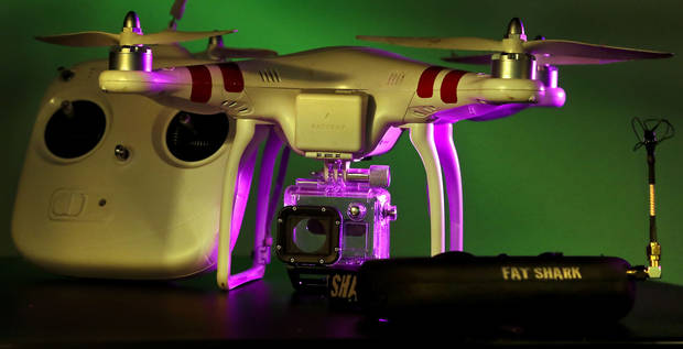 A close-up of the DJI Innovations quadrocopter, a drone, and Fat Shark vision system used by Price Edwards & Co. for real estate video and photography. <strong>CHRIS LANDSBERGER - THE OKLAHOMAN</strong>