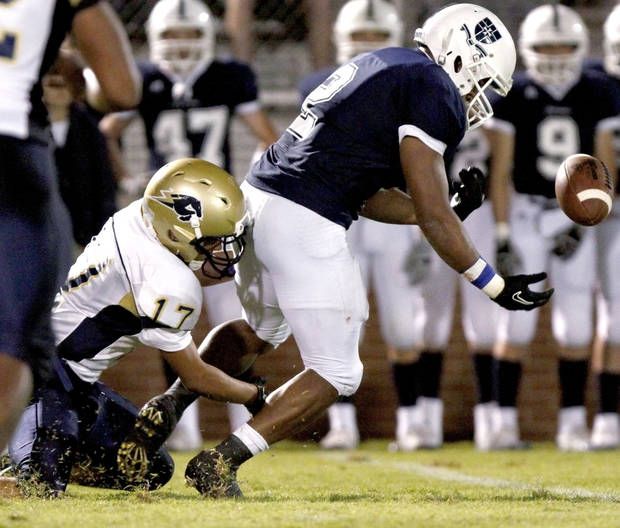 Heritage Hall�s Chedon Shockley, left, tackles Casady�s Cassius Calhoun as Calhoun loses control of the ball during a 2010 game at Casady. Photo by Bryan Terry, The Oklahoman Archives