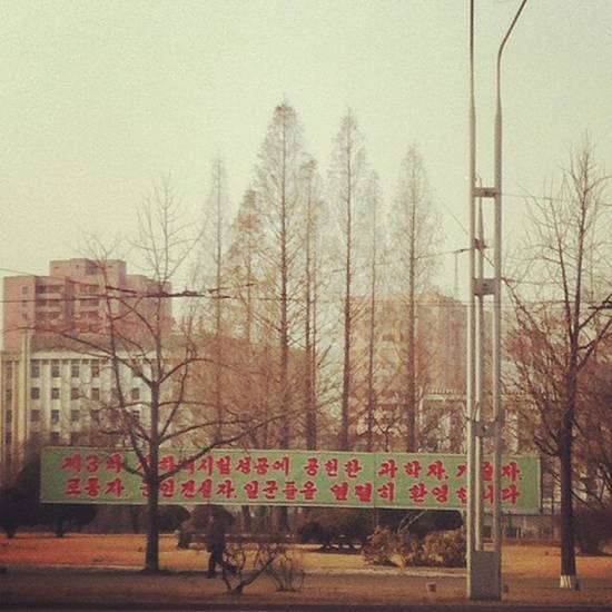 In this photo posted on Instagram, a man walks in Pyongyang, North Korea, under a new roadside banner referring to North Korea&#039;s controversial Feb. 12 nuclear test Monday, Feb. 25, 2013. Tweeting and uploading to Instagram is pretty ordinary stuff in the world of social media, but revolutionary for North Korea. (AP Photo/Jean H. Lee)