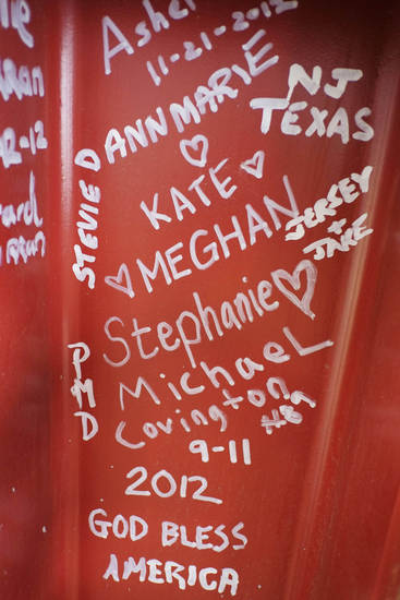 This Jan. 15, 2013 photo shows graffiti left by visitors to the World Trade Center on a steel column on the 104th floor of One World Trade Center in New York. Construction workers finishing New York's tallest building at the World Trade Center are leaving their personal marks on the concrete and steel in the form of graffiti. (AP Photo/Mark Lennihan)