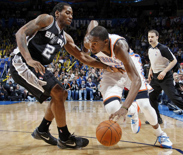 Oklahoma City's Kevin Durant (35) drives the ball against San Antonio's Kawhi Leonard (2) during the NBA basketball game between the Oklahoma City Thunder and the San Antonio Spurs at Chesapeake Energy Arena in Oklahoma City, Friday, March 16, 2012. San Antonio won, 114-105. Photo by Nate Billings, The Oklahoman