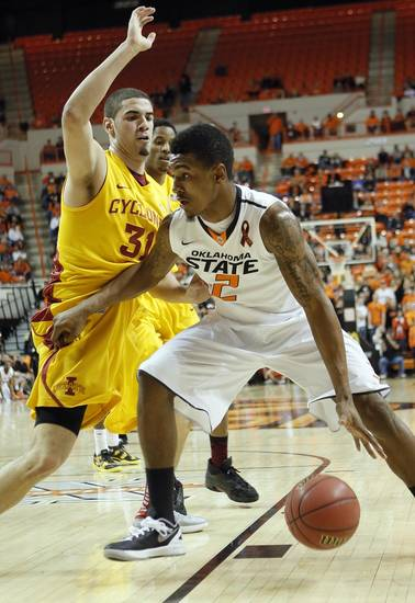 Oklahoma State Cowboys' Le'Bryan Nash (2) drives against Iowa State Cyclones' Georges Niang (31) during the college basketball game between the Oklahoma State University Cowboys (OSU) and the Iowa State University Cyclones (ISU) at Gallagher-Iba Arena on Wednesday, Jan. 30, 2013, in Stillwater, Okla.  Photo by Chris Landsberger, The Oklahoman