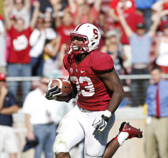 Stanford's Stepfan Taylor scores the game-winning touchdown in overtime against Arizona during an NCAA college football game in Stanford, Calif., Saturday, Oct. 6, 2012. Stanford beat Arizona 54-48.(AP Photo/George Nikitin)