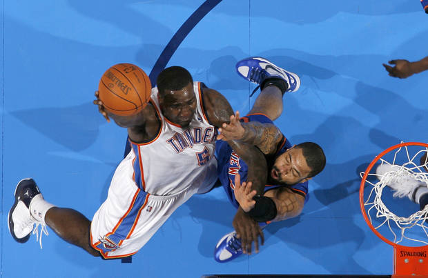 Oklahoma City's Kendrick Perkins (5) drives to the basket beside New York's Tyson Chandler (6) during the NBA game between the Oklahoma City Thunder and the New York Knicks at Chesapeake Energy Arena in Oklahoma CIty, Saturday, Jan. 14, 2012. Photo by Bryan Terry, The Oklahoman
