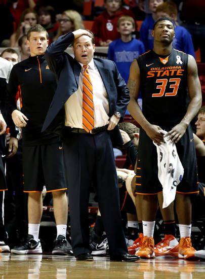 Cowboy head coach Travis Ford reacts to a referee call during the second half as the University of Oklahoma Sooners (OU) defeat  the Oklahoma State Cowboys (OSU) 77-68  in NCAA, men's college basketball at The Lloyd Noble Center on Saturday, Jan. 12, 2013  in Norman, Okla. Photo by Steve Sisney, The Oklahoman