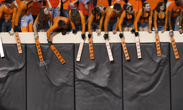 Oklahoma State fans beat their paddles against the wall during a college football game between Oklahoma State University (OSU) and the University of Texas (UT) at Boone Pickens Stadium in Stillwater, Okla., Saturday, Sept. 29, 2012. Photo by Bryan Terry, The Oklahoman