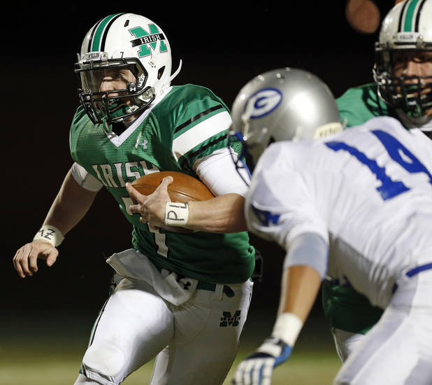 Bishop McGuinness quarterback Jacob Lewis (7) carries the ball during a high school football game between Bishop McGuinness and Guthrie at Bishop McGuinness Catholic High School in Oklahoma City, Friday, Oct. 26, 2012. Photo by Nate Billings, The Oklahoman