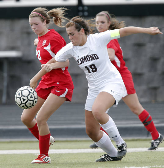 GIRLS HIGH SCHOOL SOCCER: Yukon's Sarah Wilson (18) fights for the ball with Edmond's Kenzie Burger (19) during the Bronco Cup Soccer Tournament at Mustang High School on Thursday, March 28, 2013, in Mustang, Okla.  Photo by Chris Landsberger, The Oklahoman