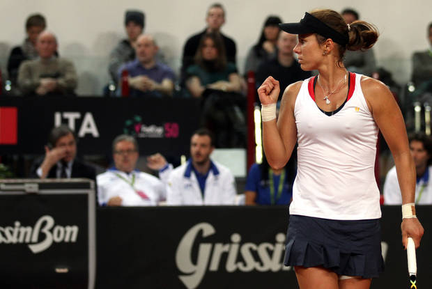 United States' Varvara Lepchenko celebrates after winning a point to Italy's Roberta Vinci during a World Group first round Fed Cup tennis match at the 105 stadium in Rimini, Saturday, Feb. 9, 2013. (AP Photo/Felice Calabro')