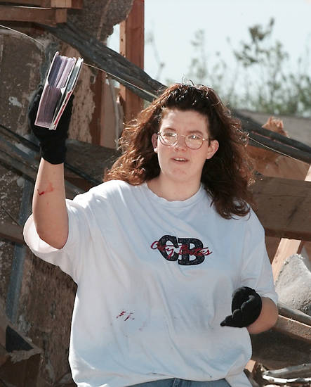 MAY 3, 1999 TORNADO: Tornado victims, damage: Holly Morgan holding up a photo album she found in the debris of her downstairs apartment at the Emerald Springs Apartments across from Westmoore High School, 12500 S Western.