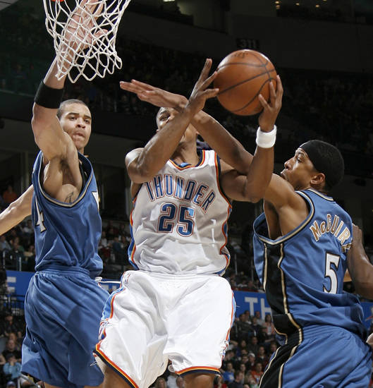 Oklahoma City's Earl Watson goes to the basket between Washington's JaVale McGee, left, and Dominic McGuire during the NBA basketball game between the Oklahoma City Thunder and the Washington Wizards at the Ford Center in Oklahoma City, Wed., March 4, 2009. PHOTO BY BRYAN TERRY, THE OKLAHOMAN