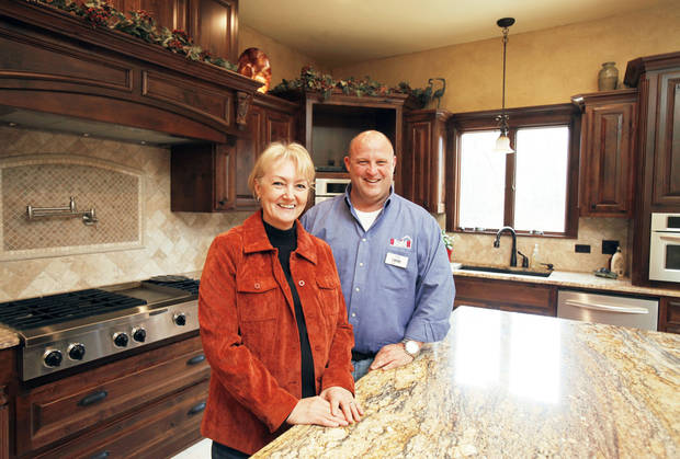 Homeowner Sharron Wolf and Bob Brauderick of UBuildIt show the kitchen of the Wolf home in Edmond. PHOTOS BY PAUL HELLSTERN, THE OKLAHOMAN