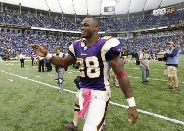 Minnesota Vikings running back Adrian Peterson reacts after an NFL football game against the Arizona Cardinals, Sunday, Oct. 9, 2011, in Minneapolis. The Vikings won 34-10. (AP Photo/Genevieve Ross)