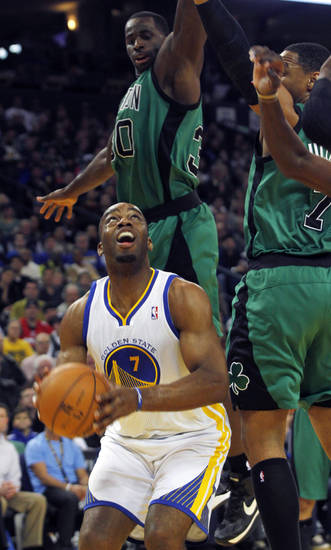 Golden State Warriors' Carl Landry (7) looks up to shoot as Boston Celtics' Brandon Bass, behind left, and Jared Sullinger defend during the first half of an NBA basketball game in Oakland, Calif., Saturday, Dec. 29, 2012. (AP Photo/George Nikitin)