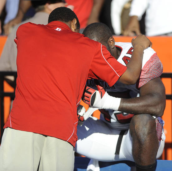 Louisiana-Lafayette defensive end Emeka Onyenekwu (45) is consoled after his team lost 27-20 to Florida in an NCAA college football game in Gainesville, Fla., Saturday, Nov. 10, 2012. (AP Photo/Phil Sandlin)
