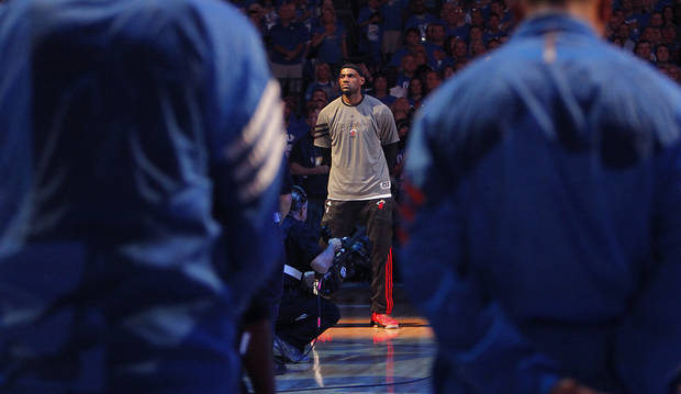 Miami's LeBron James stands during the pre game prayer during Game 1 of the NBA Finals between the Oklahoma City Thunder and the Miami Heat at Chesapeake Energy Arena in Oklahoma City, Tuesday, June 12, 2012. Photo by Chris Landsberger, The Oklahoman