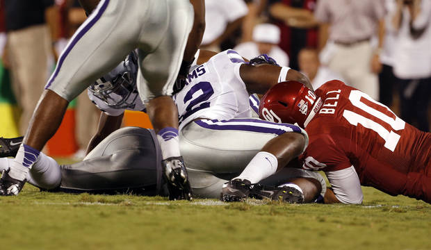 Kansas State players jump on a fumble by Blake Bell (10) during a college football game between the University of Oklahoma Sooners (OU) and the Kansas State University Wildcats (KSU) at Gaylord Family-Oklahoma Memorial Stadium, Saturday, September 22, 2012. Photo by Steve Sisney, The Oklahoman