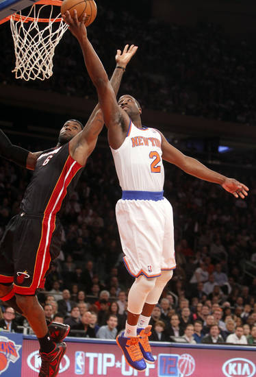 New York Knicks' Raymond Felton (2) shoots against Miami Heat's LeBron James (6) during the first half of an NBA basketball game, Friday, Nov. 2, 2012, in New York. (AP Photo/Jason DeCrow)