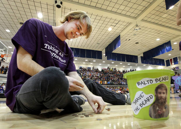 Senior Nate Parks counts change collected during the BALTO assembly at Edmond North High School. Photos By David McDaniel, The Oklahoman