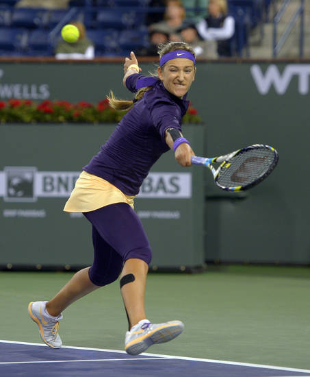 Victoria Azarenka, of Belarus, returns a shot to Daniela Hantuchova, of Slovakia, during their match at the BNP Paribas Open tennis tournament, Saturday, March 9, 2013, in Indian Wells, Calif. (AP Photo/Mark J. Terrill)