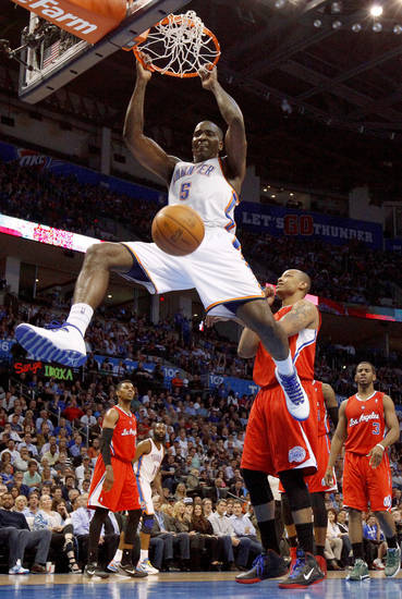 Oklahoma City's Kendrick Perkins (5) dunks the ball beside Los Angeles' Caron Butler (5) during the NBA basketball game between the Oklahoma City Thunder and the Los Angeles Clippers at Chesapeake Energy Arena in Oklahoma City, Wednesday, April 11, 2012. Photo by Bryan Terry, The Oklahoman