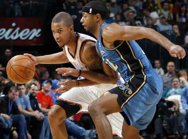 Oklahoma City's Eric Maynor (6) drives the ball past Mustafa Shakur (22) of Washington during the NBA basketball game between the Washington Wizards and the Oklahoma City Thunder at the Oklahoma City Arena in Oklahoma City, Friday, January 28, 2011. Photo by Nate Billings, The Oklahoman