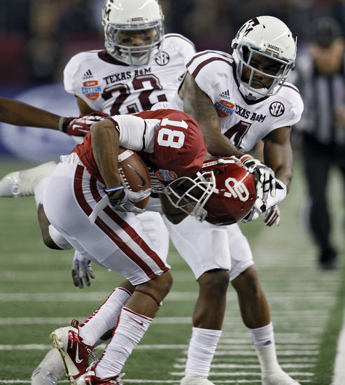 Texas A&M's Toney Hurd Jr. (4) forces Oklahoma's Jalen Saunders (18) out of bounds during the college football Cotton Bowl game between the University of Oklahoma Sooners (OU) and Texas A&M University Aggies (TXAM) at Cowboy's Stadium on Friday Jan. 4, 2013, in Arlington, Tx. Photo by Chris Landsberger, The Oklahoman