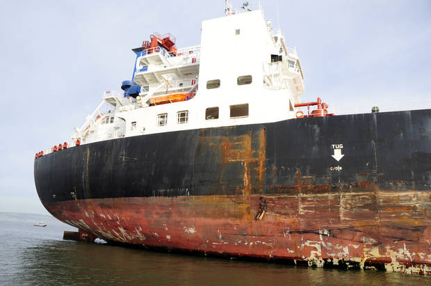 In this image provided by the Coast Guard,  damage is seen to the tanker Overseas Reymar following a collision with tower six of the San Francisco Bay Bridge, Monday, Jan. 7, 2013. The empty oil tanker ship struck the San Francisco-Oakland Bay Bridge on Monday, but there were no reports of leaking oil and the bridge remained open to traffic, officials said. (AP Photo/U.S. Coast Guard, Petty Officer 2nd Class Pamela J. Boehland)