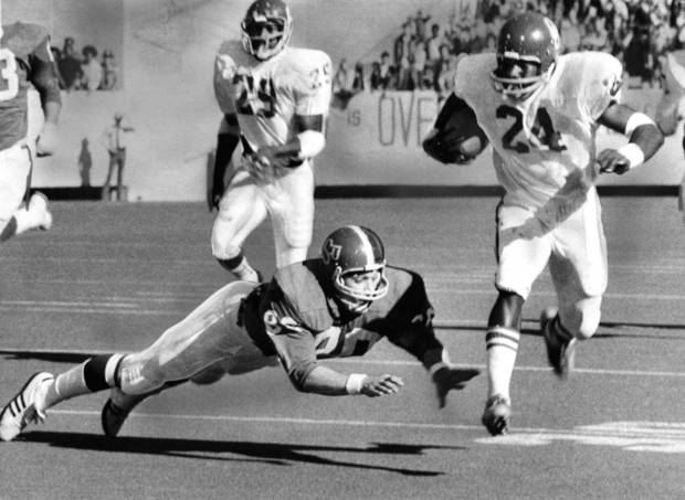 OU's Joe Washington sets sail on his early 57-yard punt return which set up the first Sooner touchdown during the Bedlam college football game on Dec. 1, 1973. The University of Oklahoma Sooners defeated the Oklahoma State Cowboys, 45-18, in Stillwater. Staff photo by Cliff Traverse