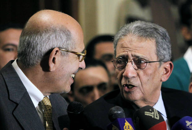 Mohamed El Baradei, left, Nobel peace laureate and former director of the U.N.'s nuclear agency, speaks with former Egyptian Foreign Minister and presidential candidate Amr Moussa during a news conference following the meeting of the National Salvation Front in Cairo, Monday, Jan. 28, 2013. The group, Egypt�s main opposition coalition, has rejected President Mohammed Morsi's call for dialogue to resolve the country�s political crisis, demanding that he first make deep concessions to break what they call the monopoly that Islamists have tried to impose on power. (AP Photo/Amr Nabil)