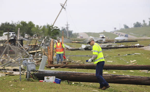 Workers for utility companies use devices  to check damage to gas meters and electrical lines in an area along State Highway 99 that received heavy damage in tornado that hit the community, located about 50 miles east of Oklahoma City,  Monday night.  Photo by Jim Beckel, The Oklahoman