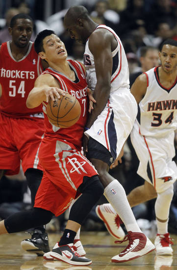 Houston Rockets point guard Jeremy Lin, front left, is fouled by Atlanta Hawks power forward Anthony Tolliver (4) while driving in the first half of an NBA basketball game on Friday, Nov. 2, 2012, in Atlanta. (AP Photo/John Bazemore)