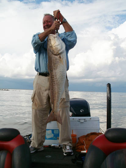 "Oklahoma Supreme Court Justice Joseph Watt caught this 35-pound redfish off the coast of Venice, La. The red fish outweighed his previous biggest three catches of redfish combined. ""Years ago, I would catch redfish down on the Texas Coast but rarely would a big one weigh 12 pounds,"" Watt said. ""One like that won't even get a nod in Venice."" The coastal waters near Venice, La., are believed by many to be among the best angling destinations in North America. Photo provided by Gary Giudice"