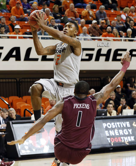 OSU's Le'Bryan Nash (2) moves to the hoop past Keith Pickens (1) of Missouri State during a men's college basketball between Oklahoma State University and Missouri State at Gallagher-Iba Arena in Stillwater, Okla., Saturday, Dec. 8, 2012. Photo by Nate Billings, The Oklahoman